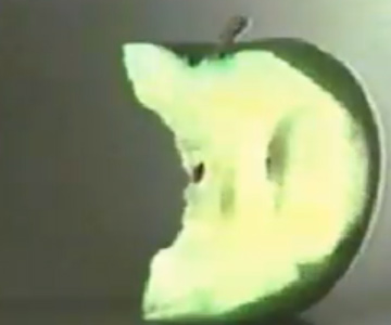 Old 1980s TV Commercial - Commodore 64 - Eating Apple One Bite at a Time